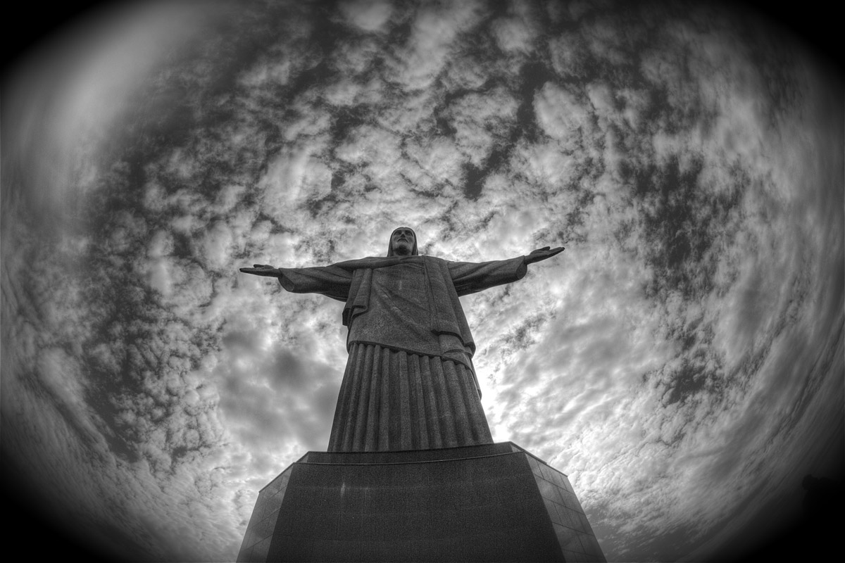 Statue of Christ The Redeemer With The World As Background