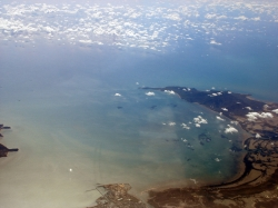 View of Great Barrier Reef Water from Boeing 737 on the Way to Cairns